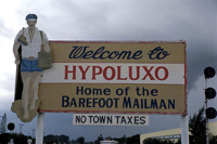 "The Town of Hypoluxo sign, billing itself as the ""Home of the Barefoot Mailman"