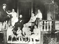 John Sundy (left) with his family on the porch of his home in Delray Beach