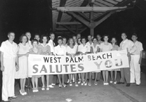 A group at the West Palm Beach train station welcomes returning servicemen