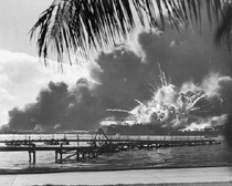 The USS Shaw explodes from the Japanese attack on Pearl Harbor